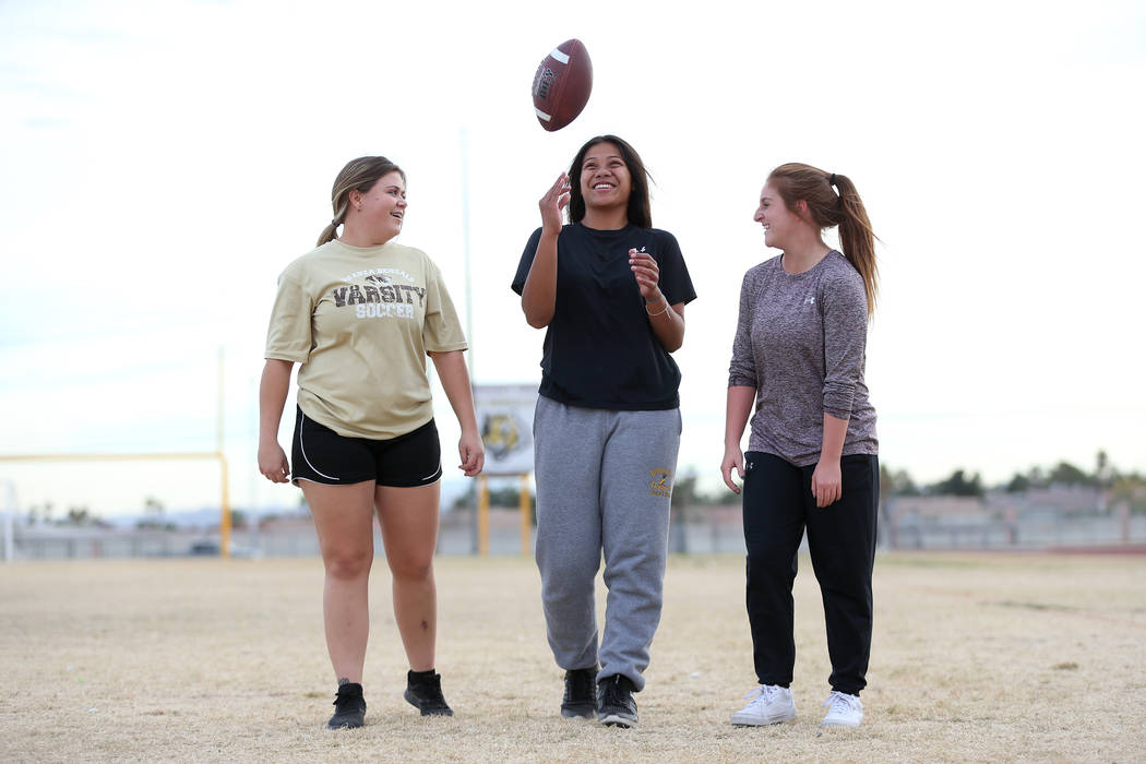 Bonanza's flag football players from left, wide receiver Alicia Kestner, 18, quarterback Cindylou Rasiang, 15, and running back Charlene Beck, 16, at Bonanza High School in Las Vegas, Tuesday, Nov ...