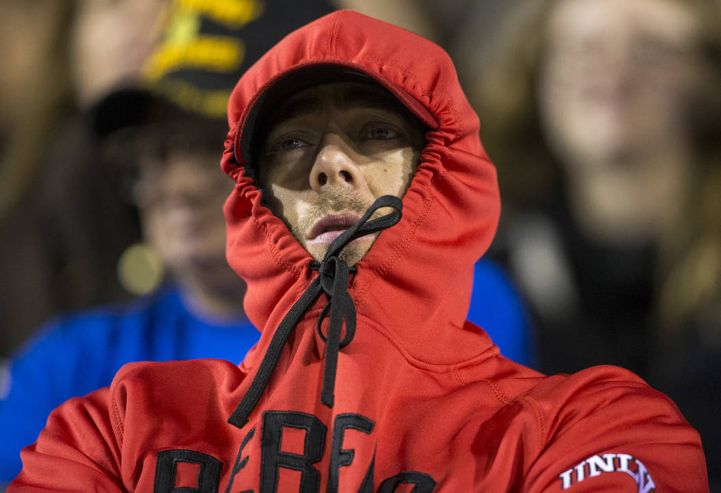 In this Saturday, Nov. 24, 2018, file photo, a spectator bundles up during the first half of the UNLV and Nevada Wolf Pack football game at Sam Boyd Stadium in Las Vegas. Richard Brian Las Vegas R ...