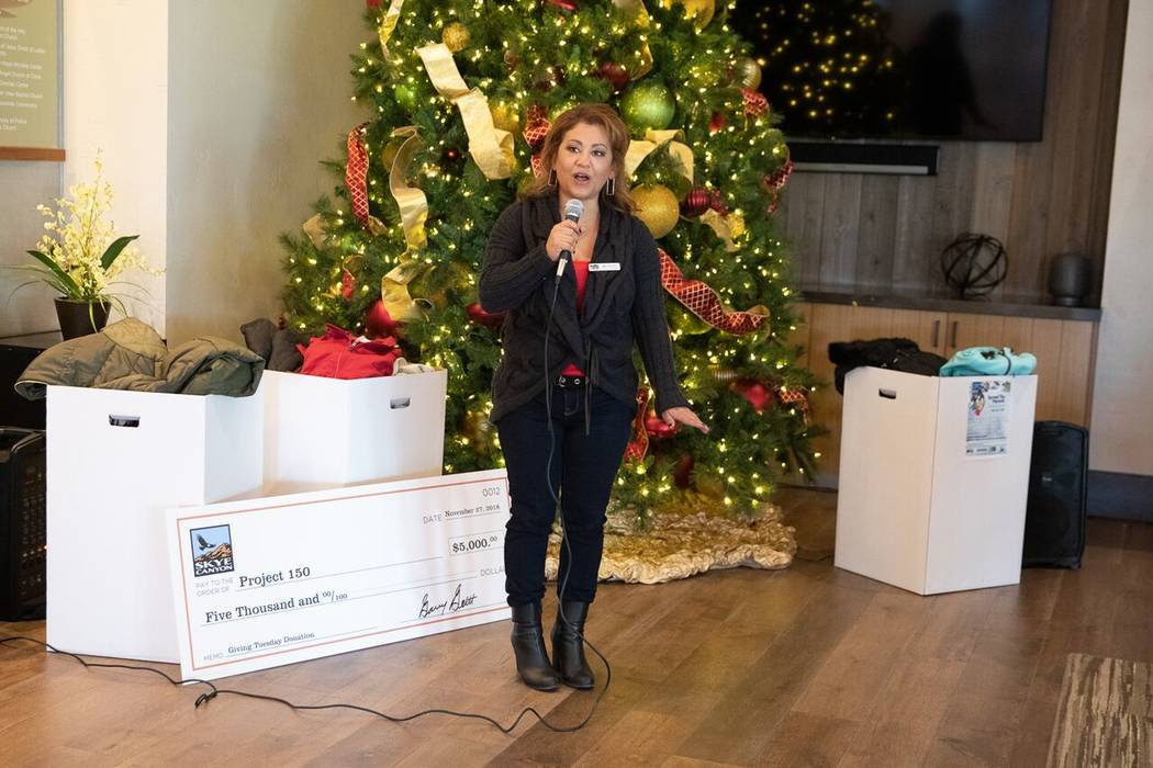 Meli Pulido, Project 150's executive director, accepted the gifts on behalf of the nonprofit. (Skye Canyon)