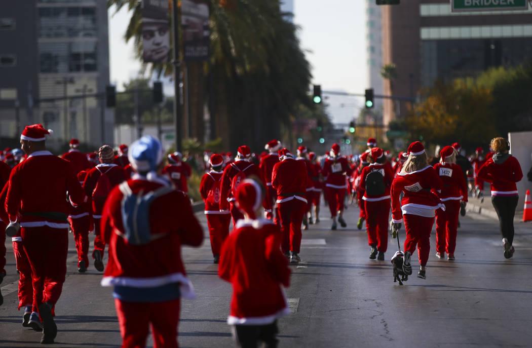 People participate during the Las Vegas Great Santa Run in downtown Las Vegas on Saturday, Dec. 2, 2017. Chase Stevens Las Vegas Review-Journal @csstevensphoto