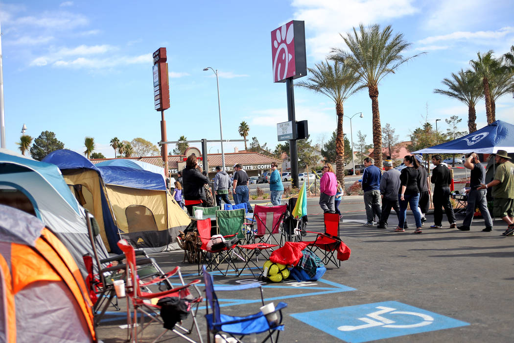 People line up for a free lunch outside the new Chick-fil-A on Rainbow Blvd. in Las Vegas, Wednesday, Nov. 28, 2018. Dozens of people camped out 24 hours before the official opening of 6 a.m. Thur ...