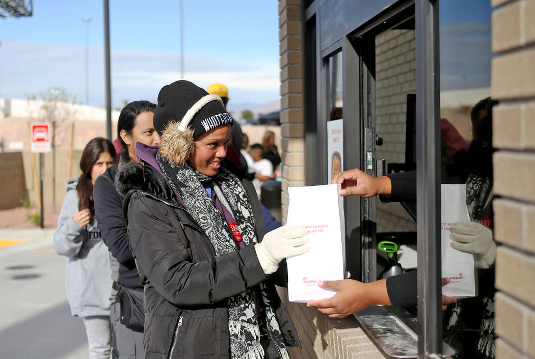 Litrease Holley receives a free lunch at the new Chick-fil-A on Rainbow Blvd. in Las Vegas, Wednesday, Nov. 28, 2018. Dozens of people camped out 24 hours before the official opening of 6 a.m. Thu ...