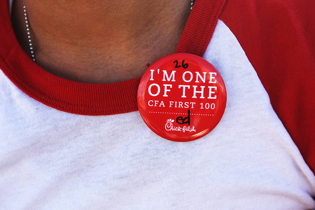 Ed Reyes shows his button as proof he is one of the first 100 customers at the new Chick-fil-A on Rainbow Blvd. in Las Vegas, Wednesday, Nov. 28, 2018. Dozens of people camped out 24 hours before ...