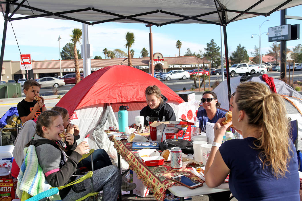 Brie Bernier, 10, from left, has a free lunch with family and friends Hannah Call, 11, Carson Call, 7, Havilah Bernier, 13, and Shannon Bernier at their campsite outside the new Chick-fil-A on Rai ...