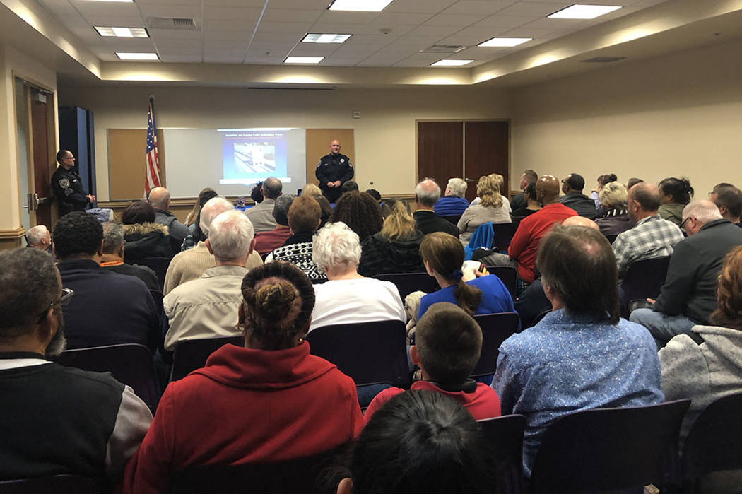 A North Las Vegas Police Department traffic officer addresses a crowd of nearly 100 North Las Vegas residents at a community meeting on Wednesday, Nov. 28, 2018. Though the meeting was scheduled t ...