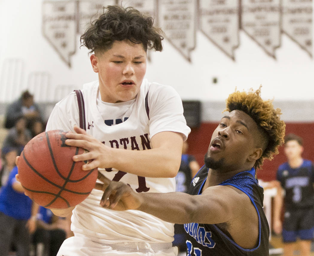 Cimarron-Memorial junior Noah Do (21) fights for a loose ball with Desert Pines senior Tavion Lucas (11) in the second quarter on Wednesday, Nov. 28, 2018, at Cimarron-Memorial High School, in Las ...