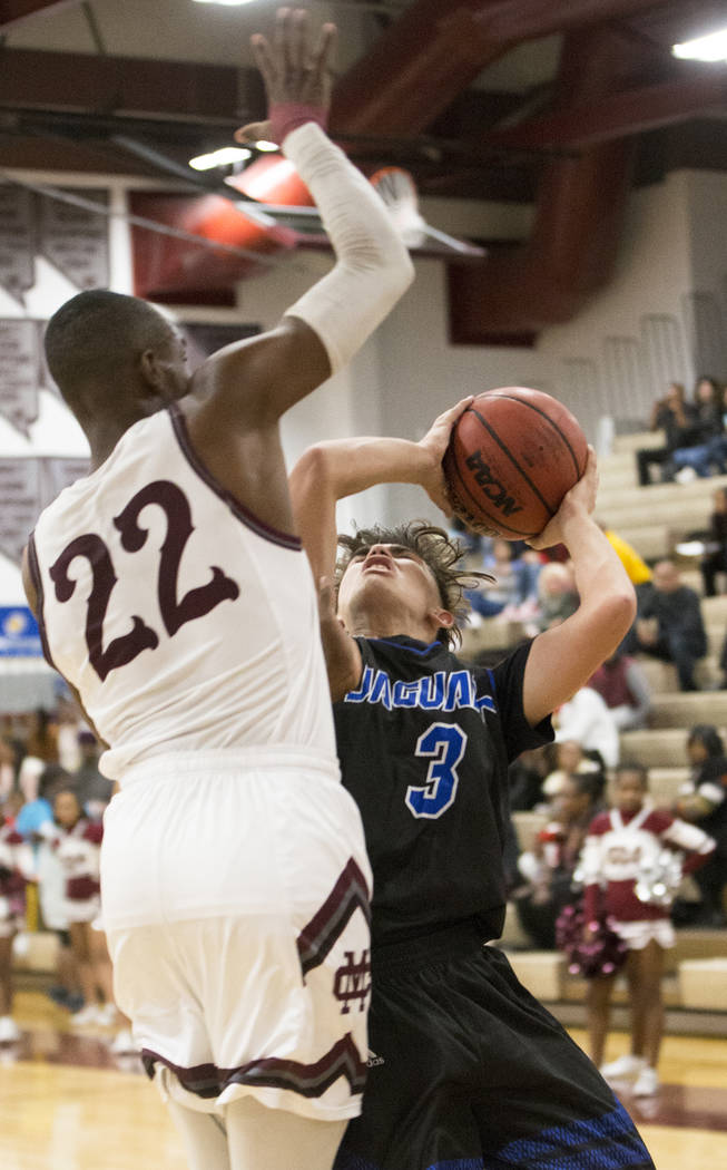 Desert Pines sophomore Cimarron Conriquez (3) drives over Cimarron-Memorial junior Makhi Walker (22) in the second quarter on Wednesday, Nov. 28, 2018, at Cimarron-Memorial High School, in Las Veg ...