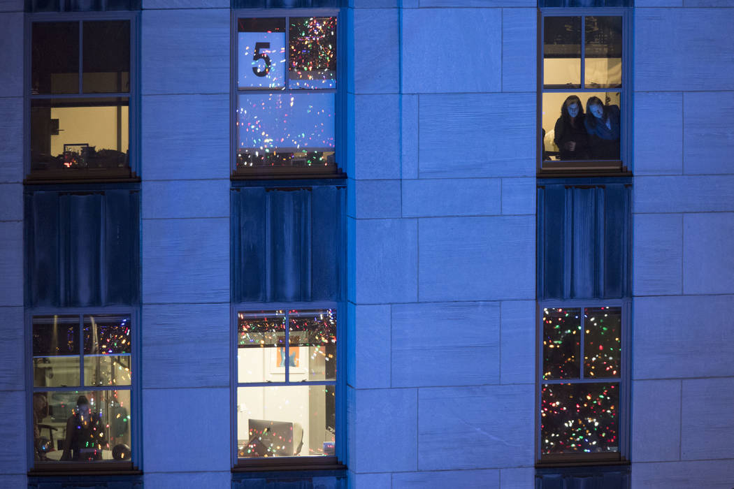 Rockefeller Center Christmas tree lights up New York City ...