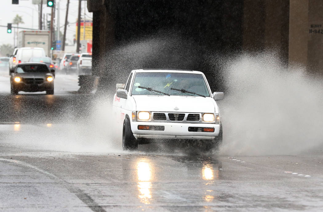 A pickup truck navigates through Bonanza Road during a rainstorm on Thursday, Nov. 29, 2019, in Las Vegas. Bizuayehu Tesfaye Las Vegas Review-Journal @bizutesfaye