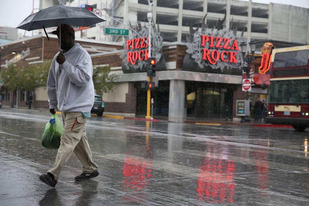 A person walks in downtown Las Vegas as rain falls, Thursday, Nov. 29, 2018. Erik Verduzco Las Vegas Review-Journal @Erik_Verduzco