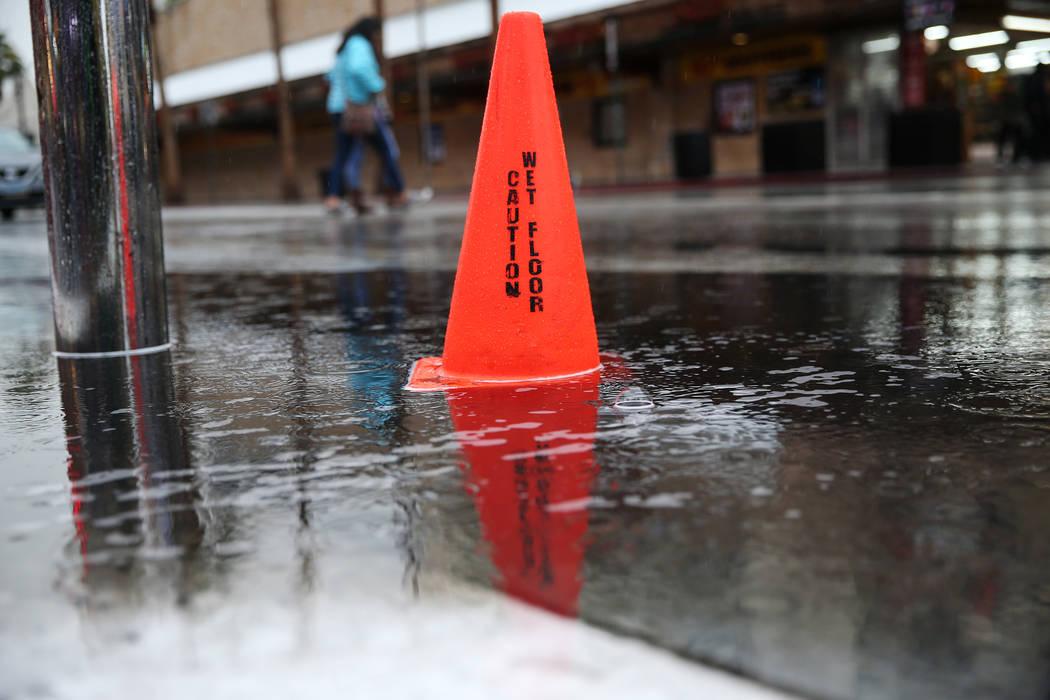 A cone sits on top of a water puddle in downtown Las Vegas as rain falls, Thursday, Nov. 29, 2018. Erik Verduzco Las Vegas Review-Journal @Erik_Verduzco