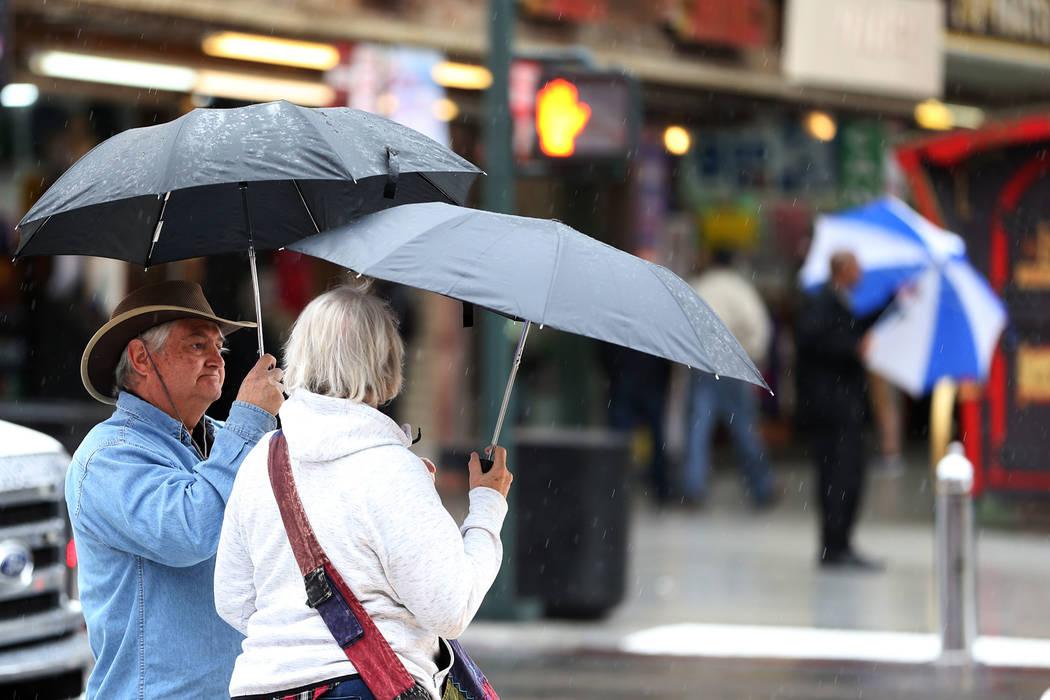People wait to cross the street as rain falls in downtown Las Vegas, Thursday, Nov. 29, 2018. Erik Verduzco Las Vegas Review-Journal @Erik_Verduzco