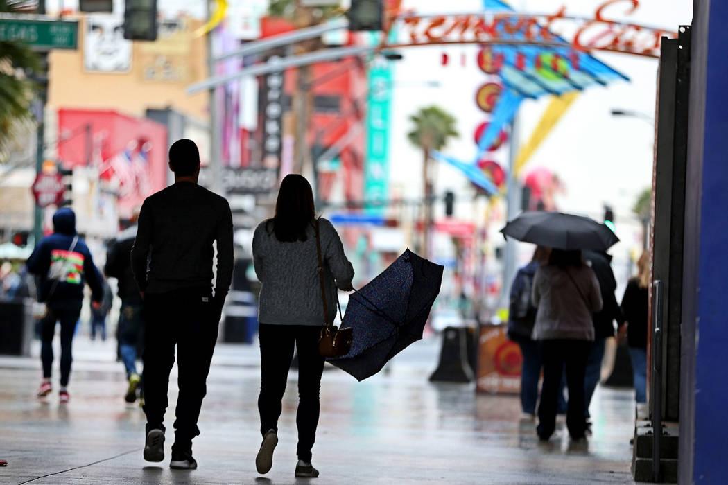 People walk in downtown Las Vegas as rain falls, Thursday, Nov. 29, 2018. Erik Verduzco Las Vegas Review-Journal @Erik_Verduzco