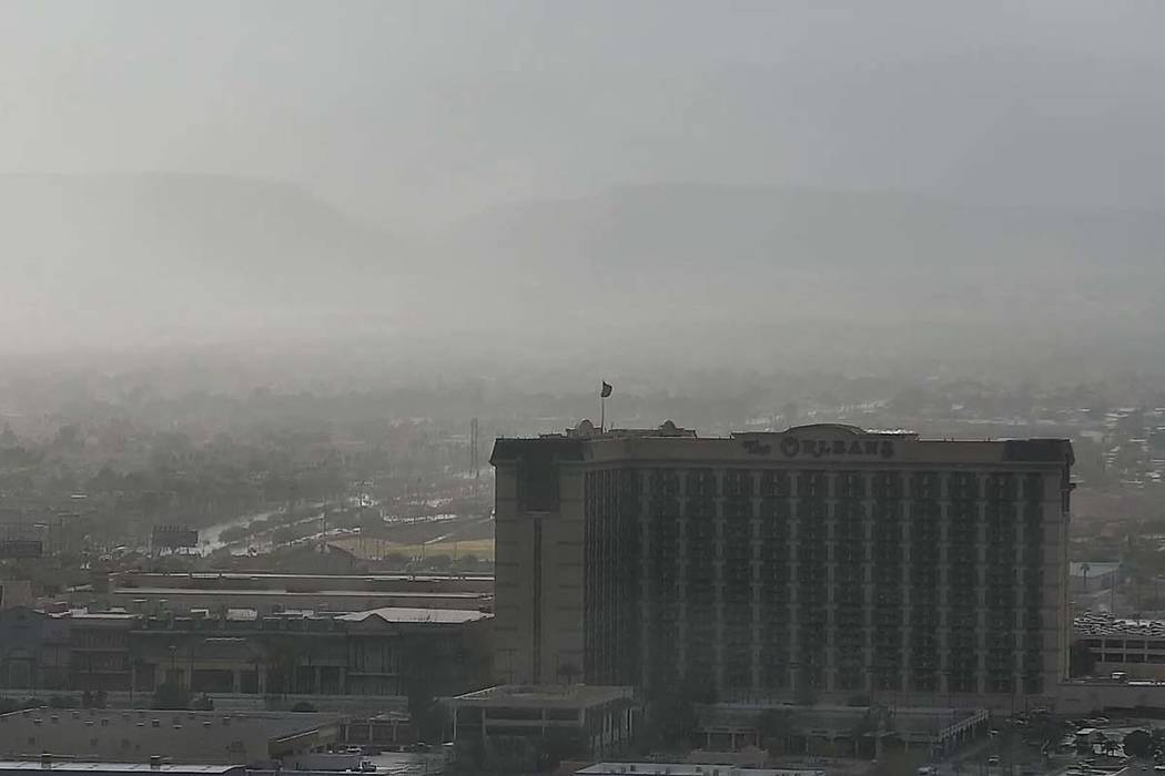 Clouds and rain obscure the Spring Mountains in this view of the western Las Vegas Valley on Thursday in this image from the Raiders stadium cam on reviewjournal.com. (Las Vegas Review-Journal)