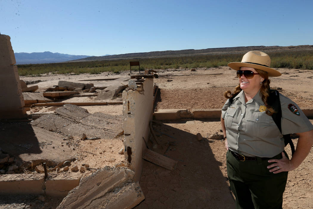 Lake Mead National Recreation Area spokeswoman Christie Vanover with the remains of the grocery store and ice cream parlor in the once-submerged St. Thomas town site Friday, Oct. 12, 2018. The tow ...