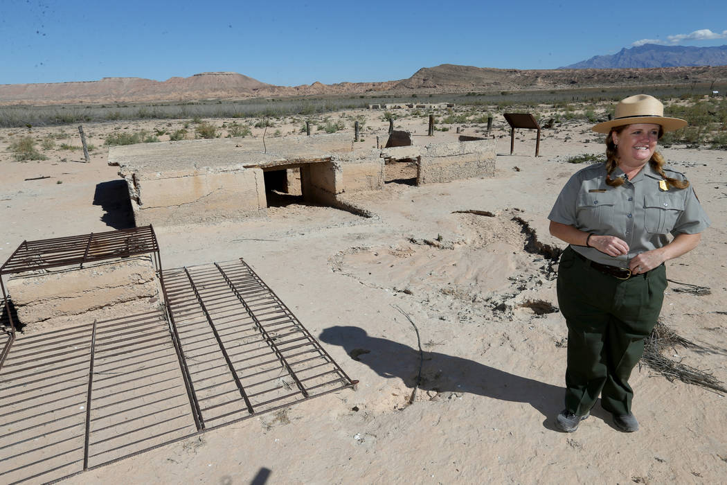 Lake Mead National Recreation Area spokeswoman Christie Vanover with the remains of the Fenton Whitney Home in the once-submerged St. Thomas town site Friday, Oct. 12, 2018. The town was swallowed ...