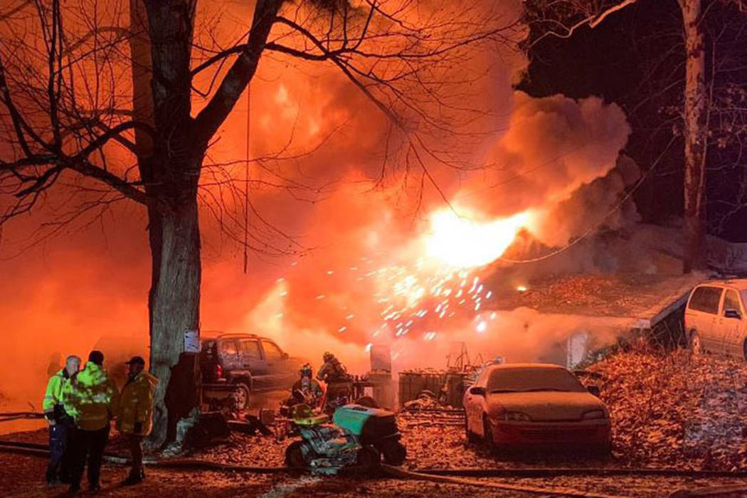 Firefighters battle an early morning house fire on Wednesday, Nov. 28, 2018 in Logansport, Ind. (Mitchell Kirk/The Kokomo Tribune via AP)