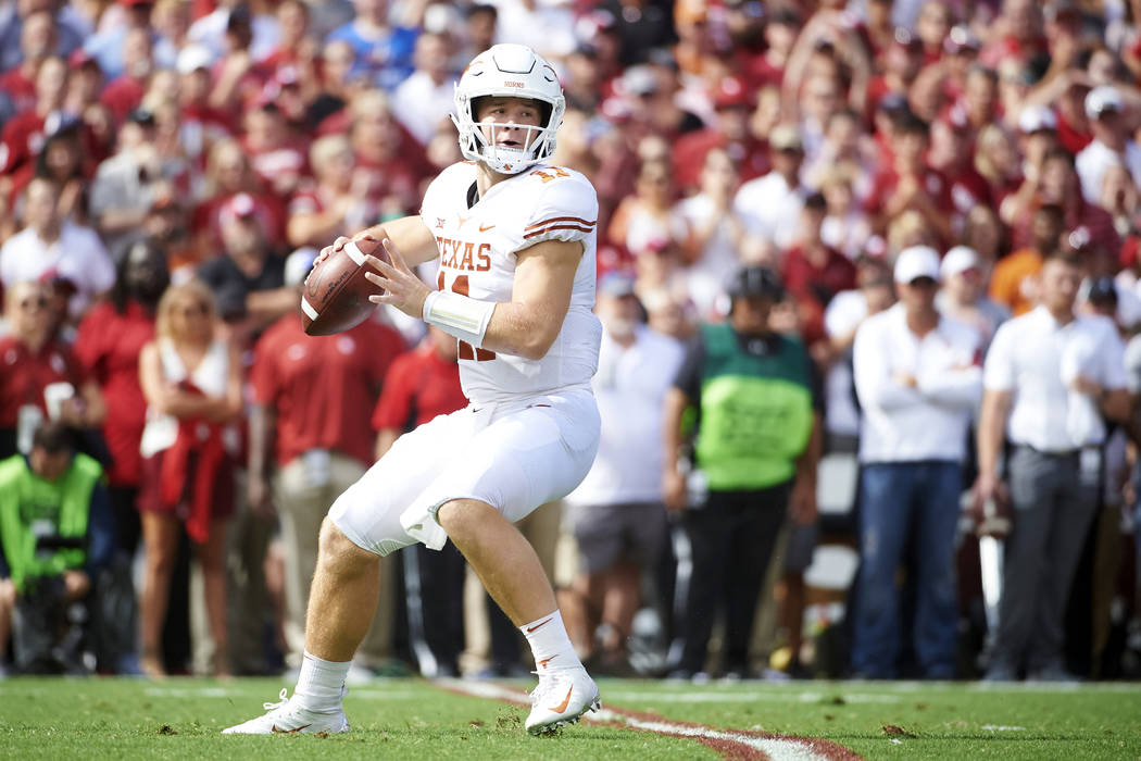 Texas quarterback Sam Ehlinger (11) drops back to pass against Oklahoma during the first half of an NCAA college football game at the Cotton Bowl, Saturday, Oct. 6, 2018, in Dallas. (AP Photo/Coop ...