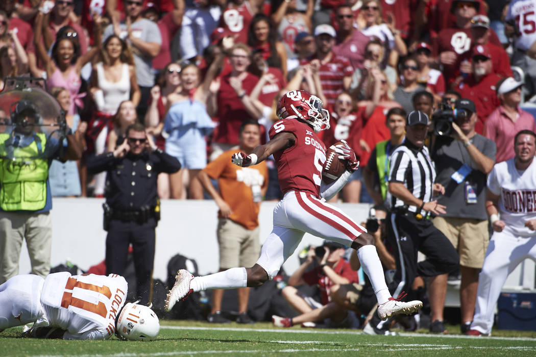 Oklahoma wide receiver Marquise Brown (5) breaks free for a 77-yard touchdown reception against Texas during the second half of an NCAA college football game at the Cotton Bowl, Saturday, Oct. 6, ...