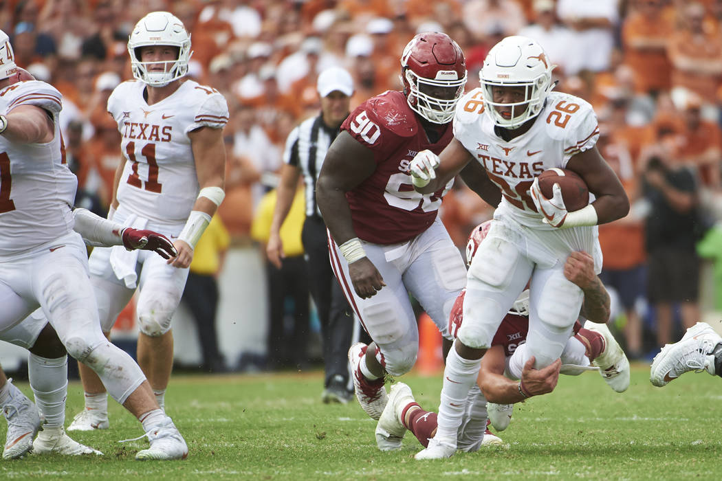 Texas running back Keaontay Ingram (26) breaks free against Oklahoma during the second half of an NCAA college football game at the Cotton Bowl, Saturday, Oct. 6, 2018, in Dallas. (AP Photo/Cooper ...