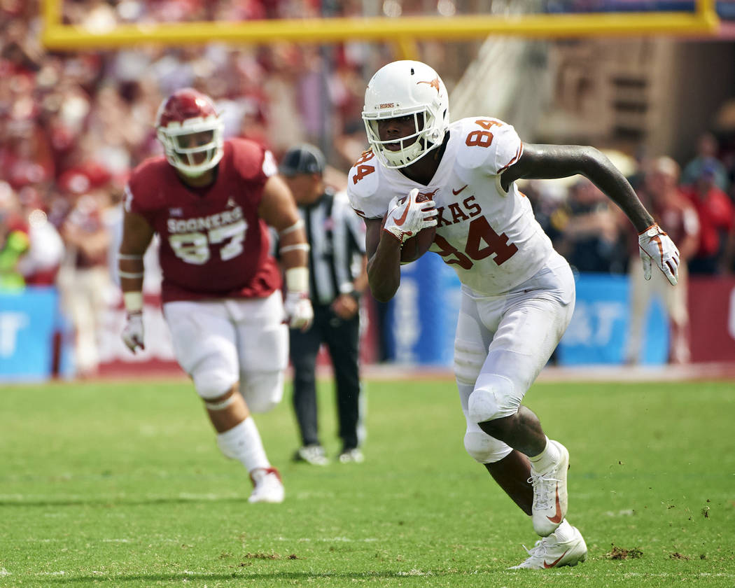 FILE - In this Saturday, Oct. 6, 2018, file photo, Texas wide receiver Lil'Jordan Humphrey (84) breaks free against Oklahoma during the second half of an NCAA college football game at the Cotton B ...