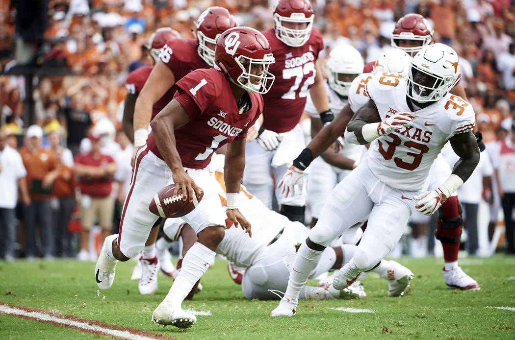 FILE - In this Oct. 6, 2018, file photo, Oklahoma quarterback Kyler Murray (1) scrambles against Texas during the first half of an NCAA college football game at the Cotton Bowl in Dallas. The Soon ...