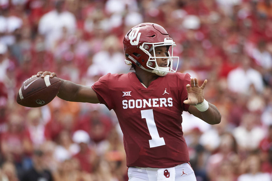 FILE - In this Oct. 6, 2018, file photo, Oklahoma quarterback Kyler Murray (1) throws a pass against Texas during the first half of an NCAA college football game at the Cotton Bowl in Dallas. The ...