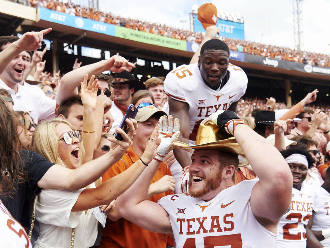 FILE - In this Oct. 6, 2018, file photo, Texas tight end Andrew Beck (47) wears the Golden Hat and celebrates with fans after defeating Oklahoma 48-45 in an NCAA college football game at the Cotto ...