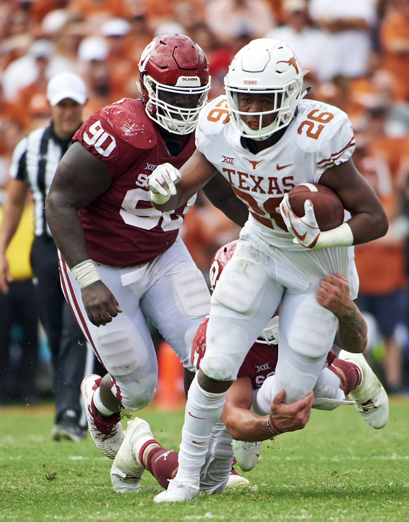 FILE - In this Oct. 6, 2018, file photo, Texas running back Keaontay Ingram (26) breaks free against Oklahoma during the second half of an NCAA college football game at the Cotton Bowl in Dallas. ...