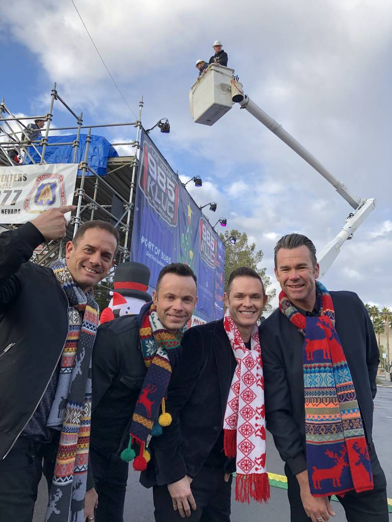 Members of Human Nature are shown at the 20th annual KLUC Toy Drive as Chet Buchanan is lifted to his temporary home 30 feet above the street at NV Energy's headquarters on West Sahara Avenue. (Ca ...