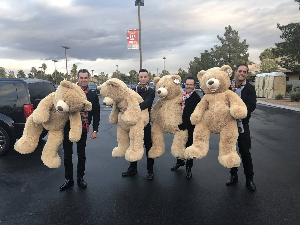 Members of Human Nature are shown with their giant teddy bears at the 20th annual KLUC Toy Drive at NV Energy's headquarters on West Sahara Avenue. (Caprio Media Design)