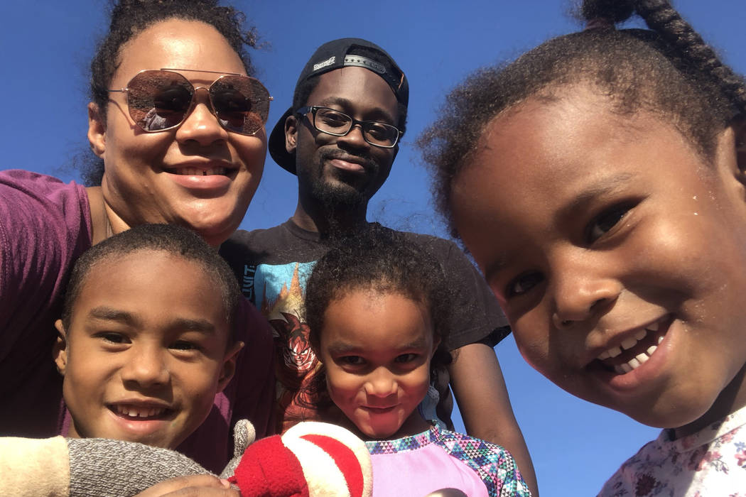 Emily Allen poses with her boyfriend and children, Andrea Harris, 3, Adesina Neal, 6 and William Neal, 5. While the Neal children have been on Medicaid since birth, Allen's youngest, Harris, is un ...