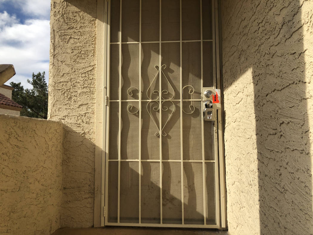 A broken seal of an apartment can be seen on Tuesday, Nov. 27, 2018, on the 2900 block of Juniper Hills Boulevard. Las Vegas police say a woman was sexually assaulted and strangled inside the apar ...