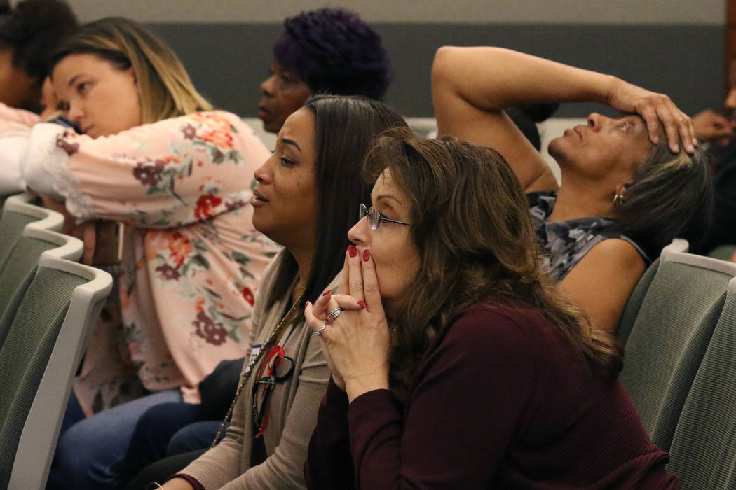 Sharithea Everett, second from right, a mother of a fatal crash victims, Robert Roberts, 23, and Jermaine Lovell Asher, 22, and her mother Shirley Taylor, third from right, listen as a prosecutor ...