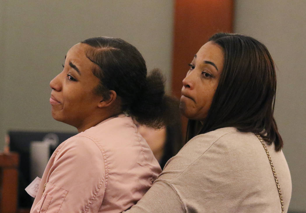 Sharithea Everett, right, a mother of a fatal crash victims, Robert Roberts, 23, and Jermaine Lovell Asher, 22, holds her daughter Xzaavier Ellis as Ellis delivers her victim impact statement to t ...