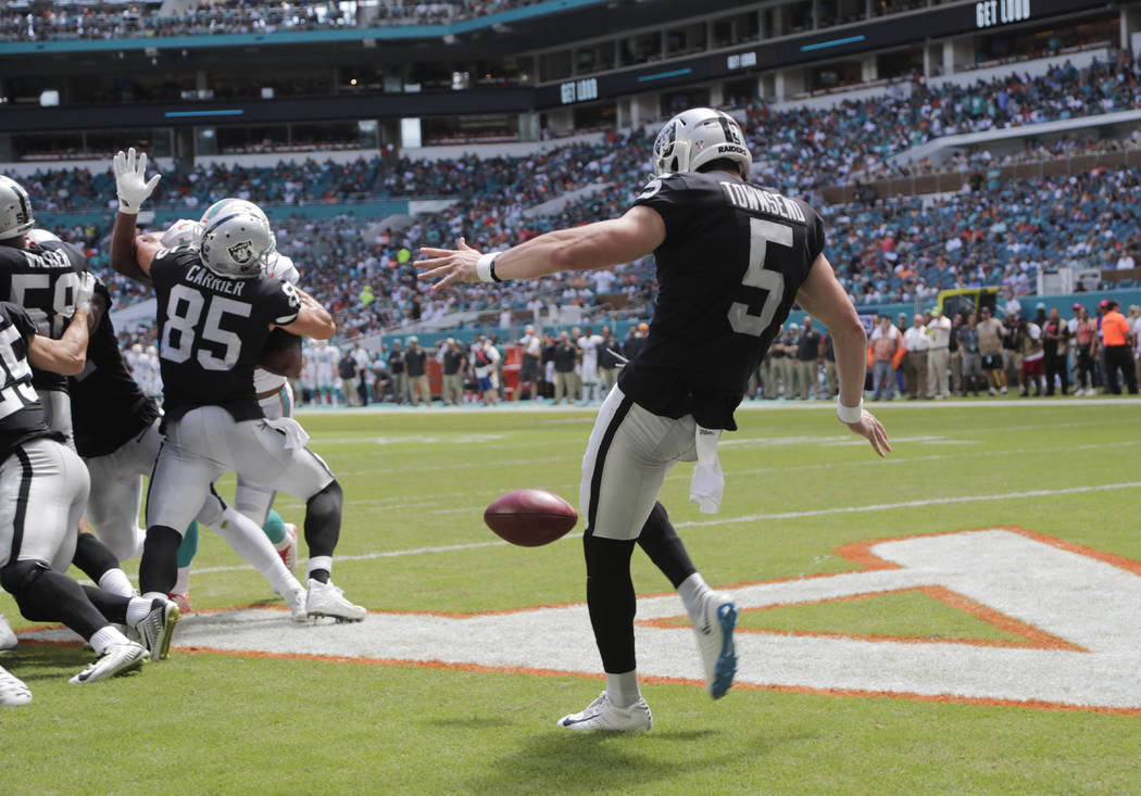 Oakland Raiders punter Johnny Townsend (5) punts the ball on the fourth down during the first half of an NFL football game against the Miami Dolphins, Sunday, Sept. 23, 2018 in Miami Gardens, Fla. ...