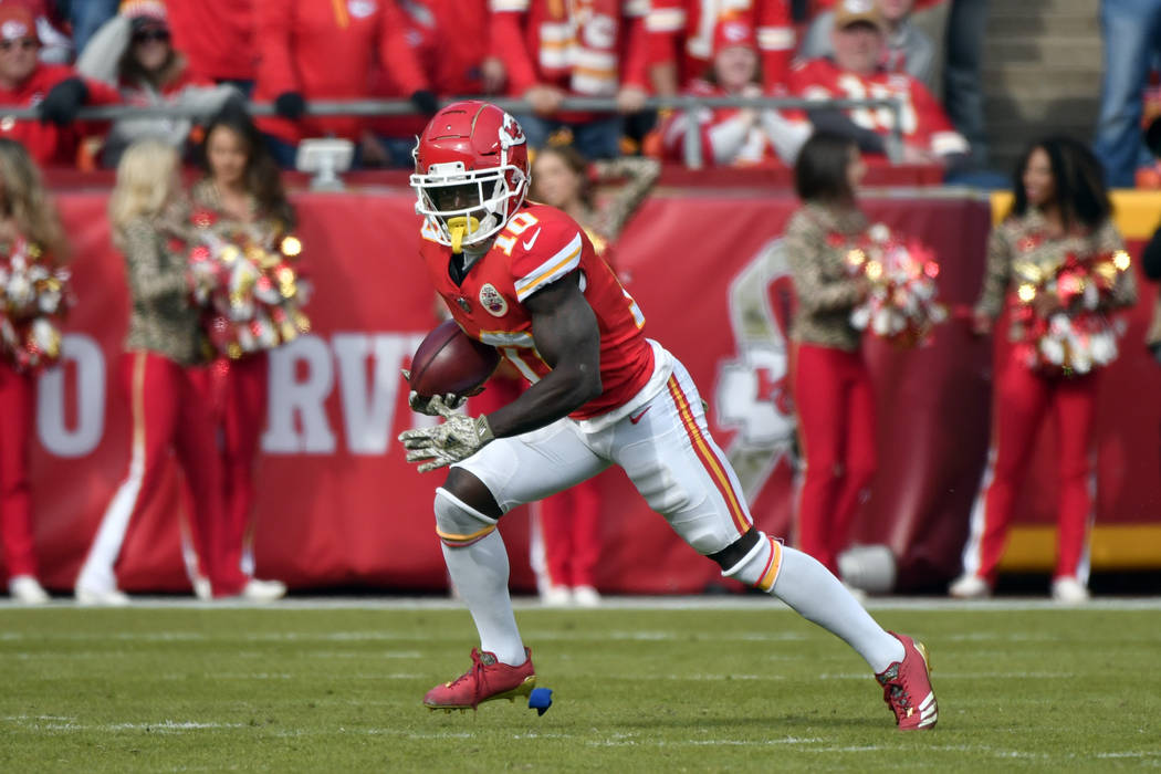 Kansas City Chiefs wide receiver Tyreek Hill (10) carries a punt return during the first half of an NFL football game against the Arizona Cardinals in Kansas City, Mo., Sunday, Nov. 11, 2018. (AP ...