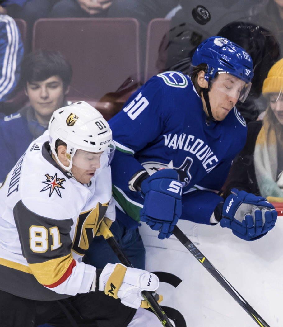 Vegas Golden Knights' Jonathan Marchessault (81) and Vancouver Canucks' Markus Granlund (60), of Finland, collide during the second period of an NHL hockey game Thursday, Nov. 29, 2018, in Vancouv ...
