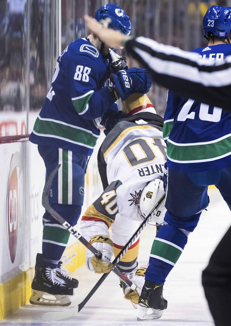 Vancouver Canucks' Adam Gaudette (88) is hit in the face by Vegas Golden Knights' Ryan Carpenter's skate as they during the third period of an NHL hockey game Thursday, Nov. 29, 2018, in Vancouver ...