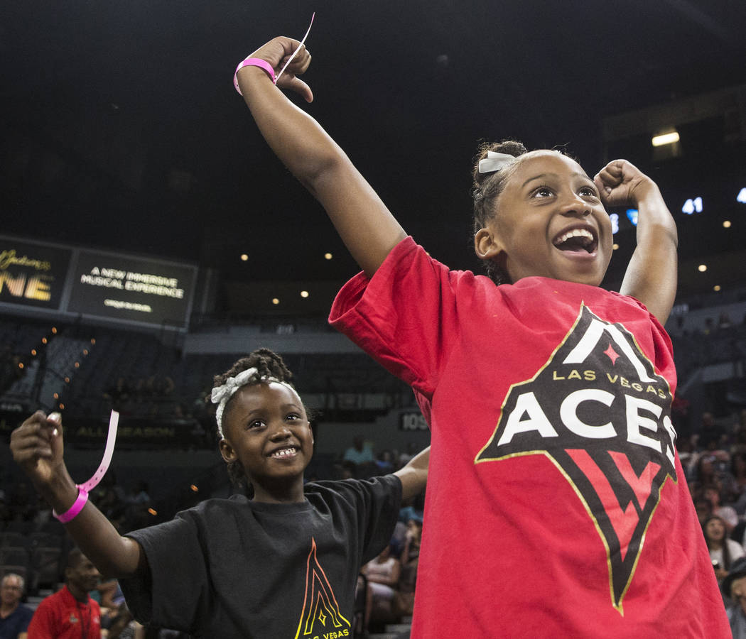 Aces fans Eva Jordan, right, and Morgan Brown cheer for Las Vegas in the 1st quarter during their matchup with the Dallas Wings on Wednesday, June 27, 2018, at the Mandalay Bay Events Center, in L ...