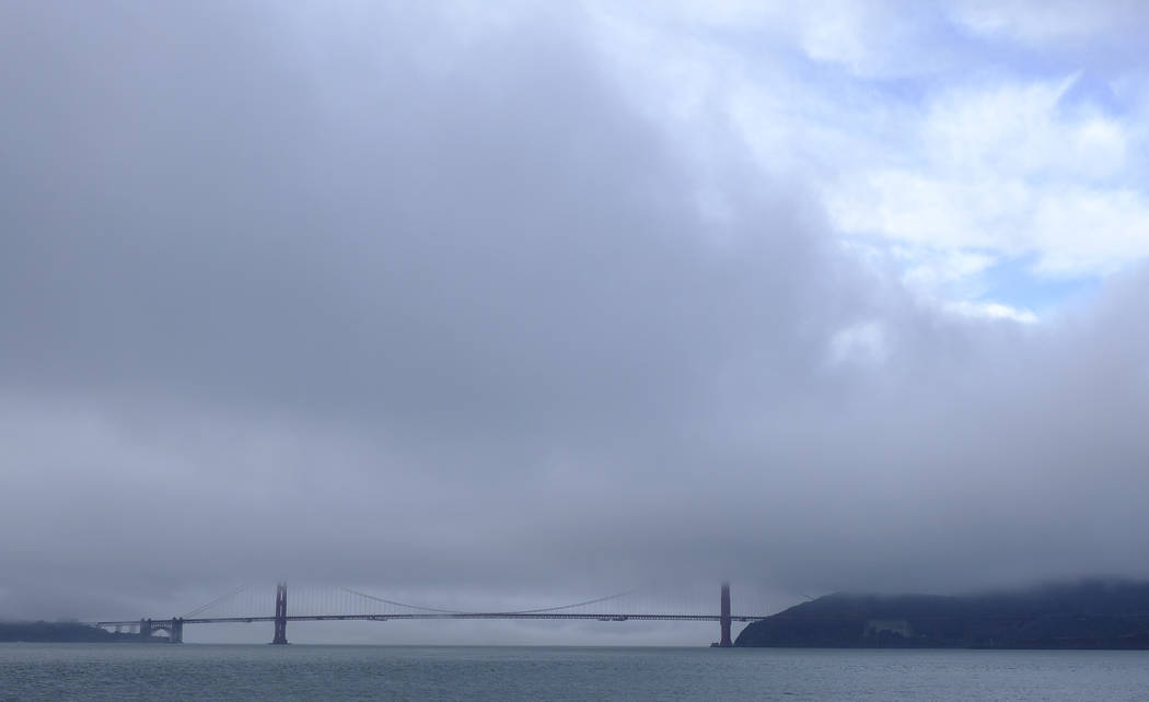 A break in the weather appears over the Golden Gate Bridge Wednesday, Nov. 28, 2018, in San Francisco. Forecasters say California will see widespread rain and heavy Sierra Nevada snowfall starting ...