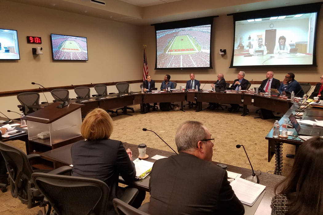 The Nevada Board of Regents view a video showing UNLV's colors and turf markings at the planned Las Vegas football stadium Thursday, Jan. 4, 2018, at a special meeting at the Nevada System of High ...