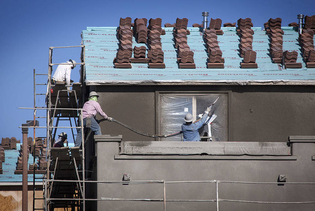 Workers build a home in Summerlin in 2014. (Las Vegas Review-Journal)