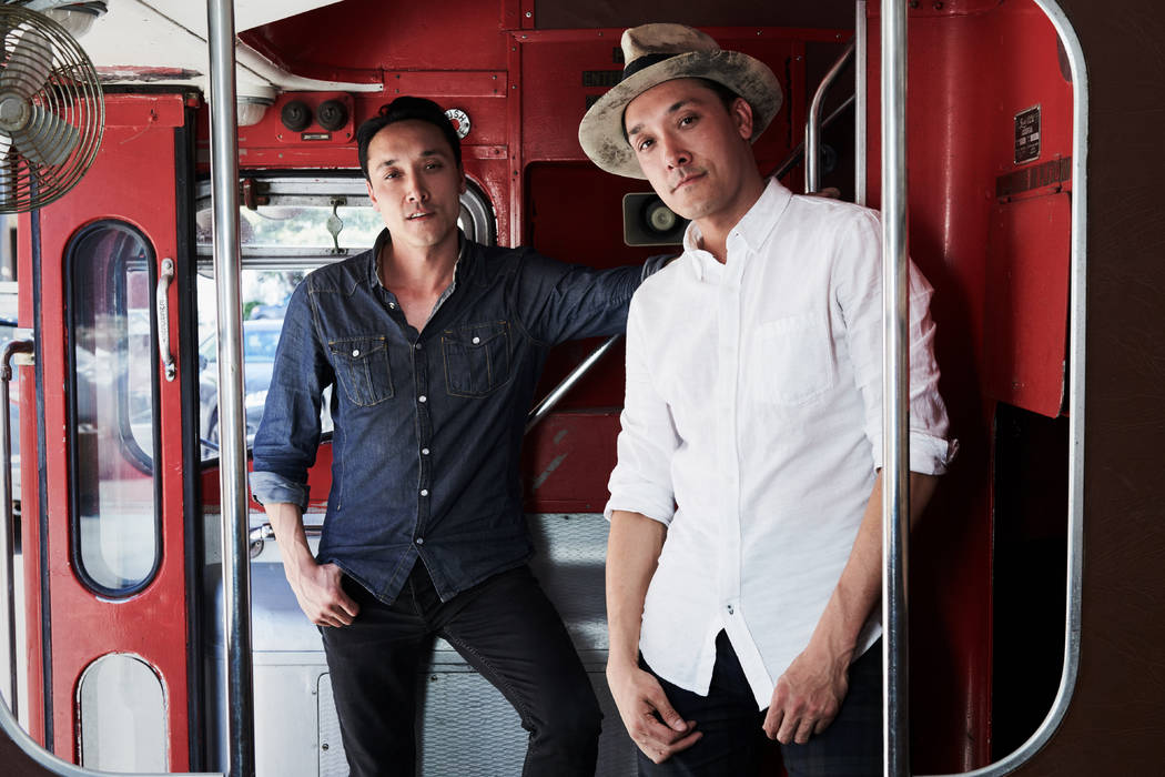 Jonnie and Mark Houston are shown on the 1963 Bristol Lodekka passenger bus being converted into a DJ booth for their new Strip nightspot, On The Record, set to open over New Year's weekend at The ...