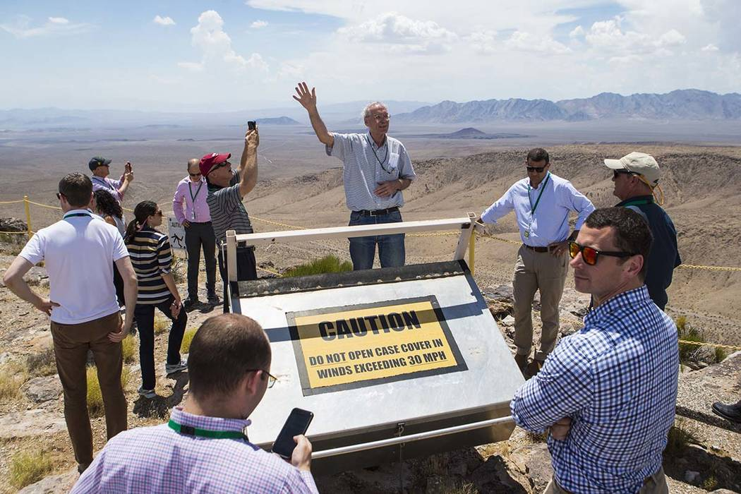 William Boyle of the Department of Energy's Office of Nuclear Energy, center, speaks at the crest of Yucca Mountain during a congressional tour near Mercury on Saturday, July 14, 2018. Chase Steve ...