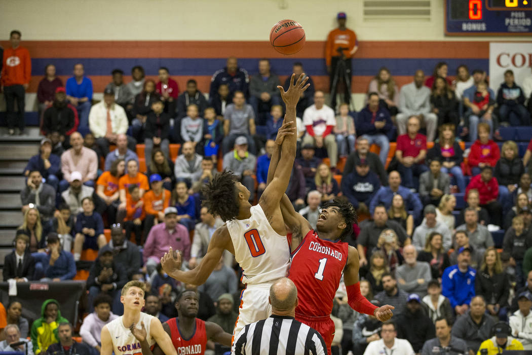 Bishop Gorman's Isaiah Cottrell (0) and Coronado's Jaden Hardy (1) tip off during the first half of a varsity basketball game at Bishop Gorman High School in Las Vegas on Thursday, Nov. 29, 2018. ...