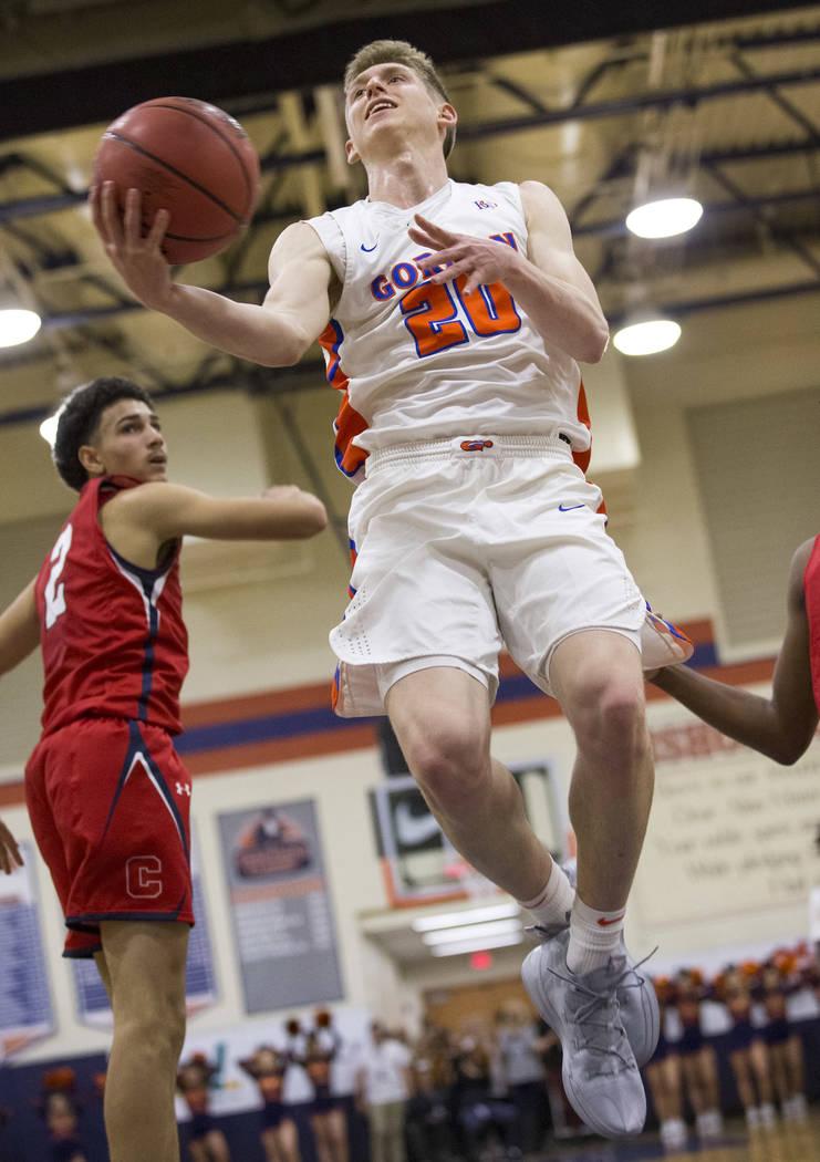 Bishop Gorman's Noah Taitz (20) goes up for a shot against Coronado during the first half of a varsity basketball game at Bishop Gorman High School in Las Vegas on Thursday, Nov. 29, 2018. Richard ...