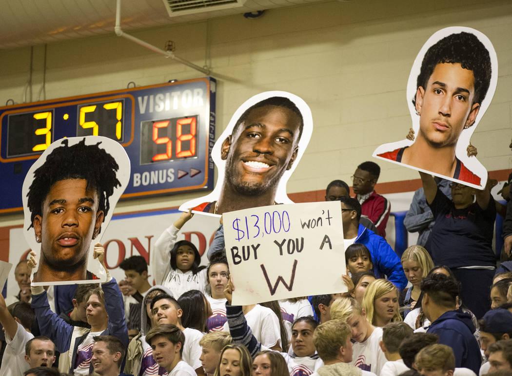 Coronado fans holds up signs during the second half of a varsity basketball game against Bishop Gorman at Bishop Gorman High School in Las Vegas on Thursday, Nov. 29, 2018. Richard Brian Las Vegas ...