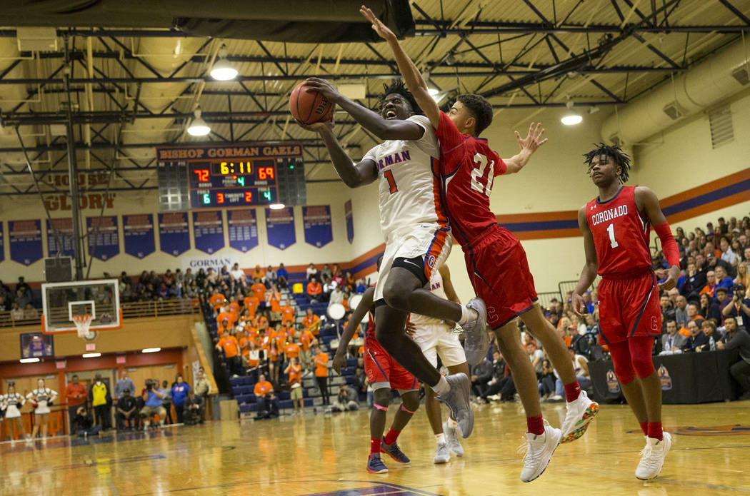Bishop Gorman's Will McClendon (1) attempts a shot against Coronado's Max Howard (21) during the second half of a varsity basketball game at Bishop Gorman High School in Las Vegas on Thursday, Nov ...