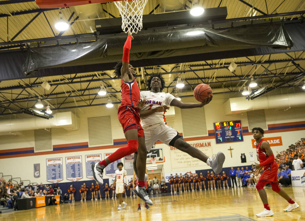 Bishop Gorman's Will McClendon (1) goes up for a shot against Coronado's Felix Reeves (5) during the first half of a varsity basketball game at Bishop Gorman High School in Las Vegas on Thursday, ...
